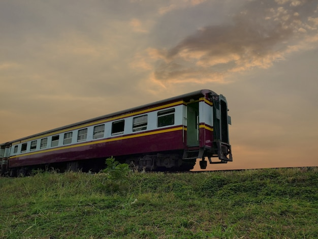 Train with railway at sunset