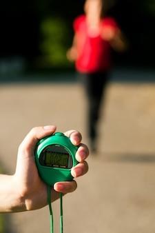 Trainer measuring time of runner