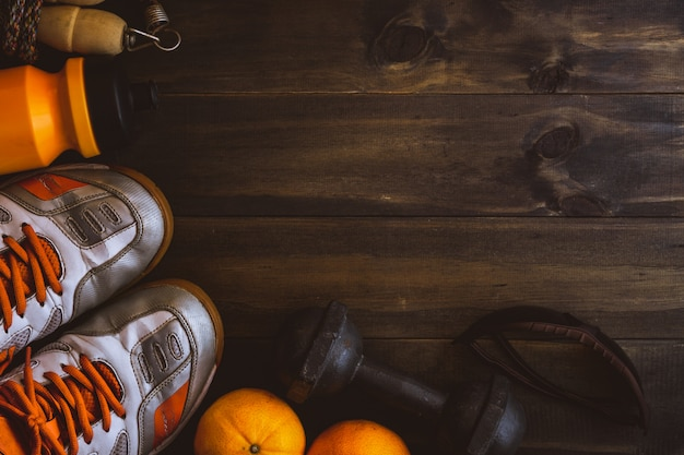Trainers and fruit on wooden table