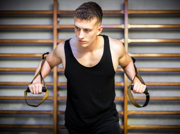 Training arms with trx fitness straps