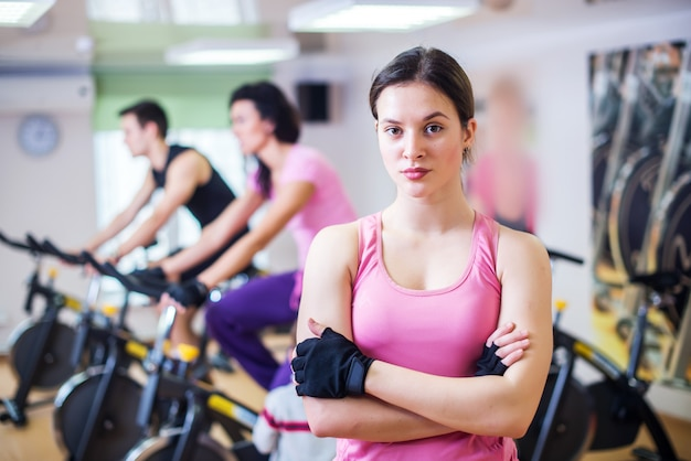 Training people biking in the gym