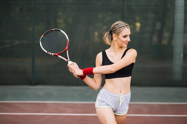 Training tennis time with young woman