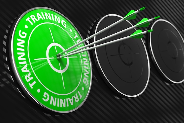 Training - three arrows hitting the center of green target on black background.