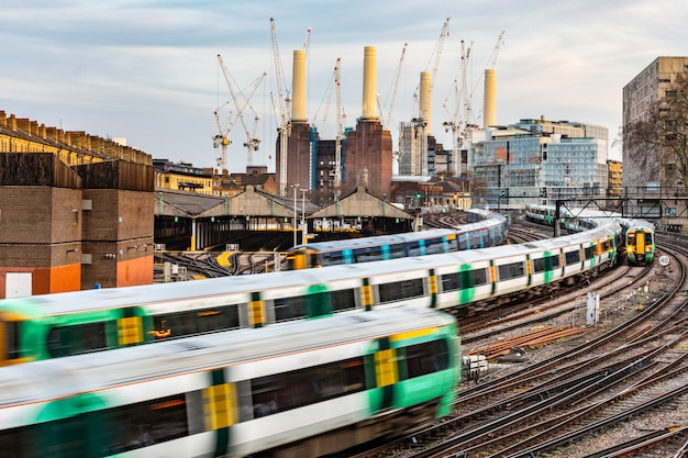 Trains on the tracks and power station  in london