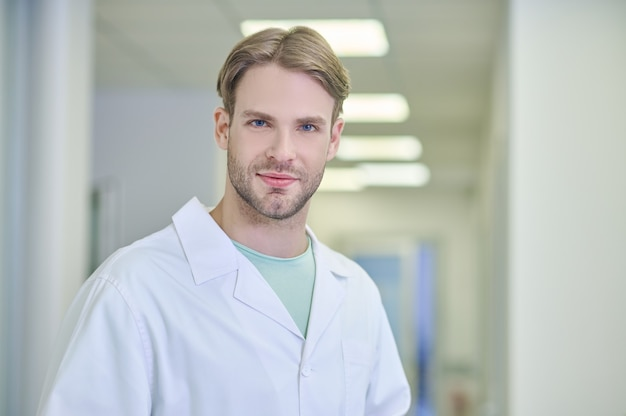 Tranquil attractive doctor posing for the camera in the workplace