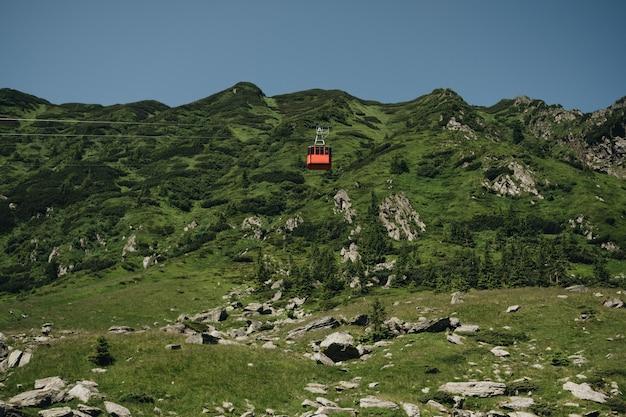 Transfagarasan cable way in green transilvanian carpathian mountains, romania