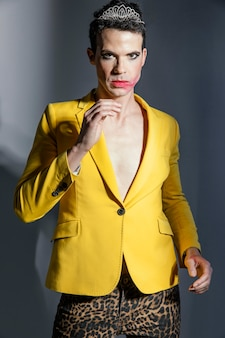 Transgender person wearing yellow jacket front view