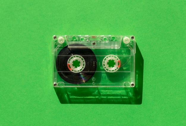 Transparent audio cassette tape on green