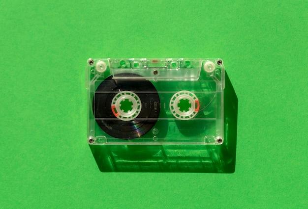 Transparent audio cassette tape on green