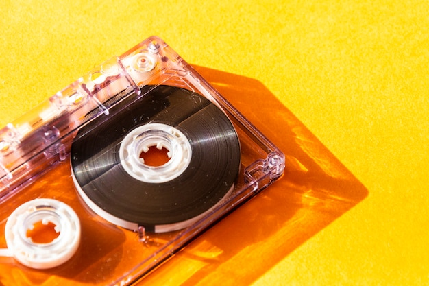 Transparent audio cassette tape. retro music magnetic technology