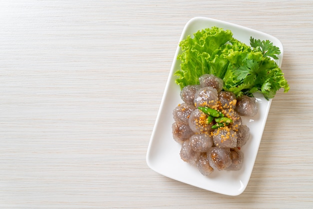 The transparent balls are called saku sai moo or steamed tapioca dumplings ball with pork filling