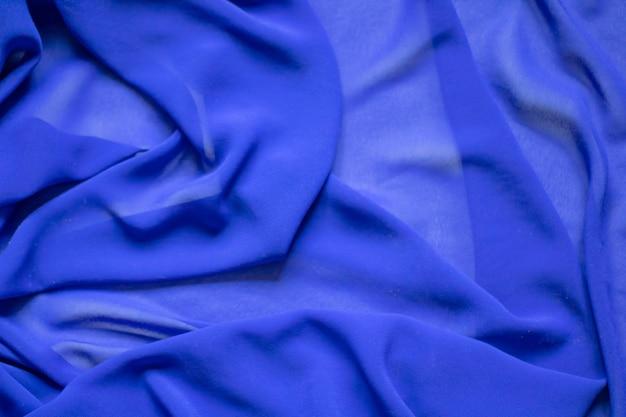 블루 패브릭의 큰 주름 추상적 인 배경 배경 투명 블루 패브릭