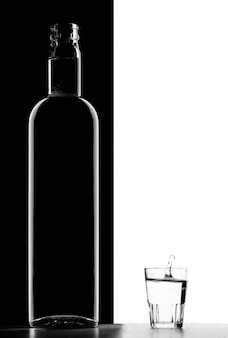 Transparent bottle and glass