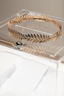 Transparent box and golden crown close-up