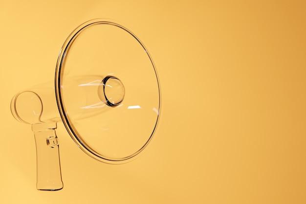 Прозрачный мультяшный громкоговоритель на желтом монохромном фоне.