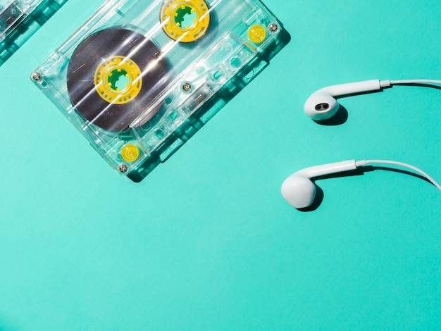 Transparent cassette tape with headphones and copy-space