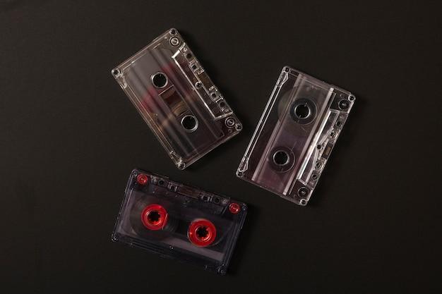 Transparent cassette tapes on black background