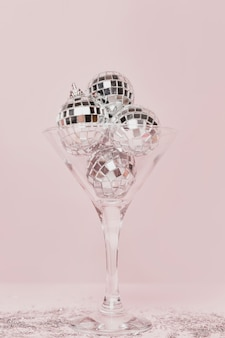 Transparent champagne glass with silver balls