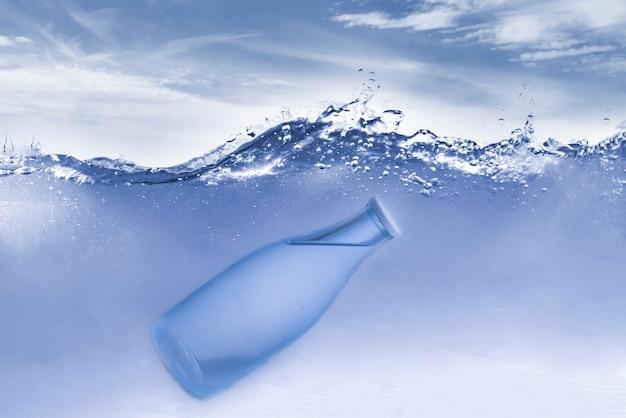 The transparent glass bottle underwater in ocean
