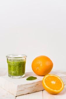 Transparent glass with orange arrangement