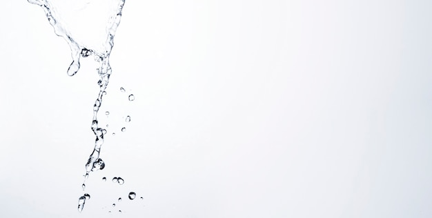 Transparent liquid drops on light background with copy space