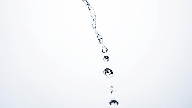 Transparent liquid drops on light background