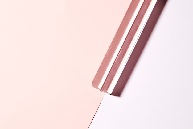 Transparent long crystal on dual pink background