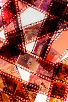 Transparent negative film stripes on white backdrop