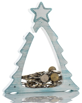 Transparent piggy bank for coins in the shape of a christmas tree. isolated