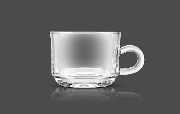 Transparent tea cup isolated on gray background
