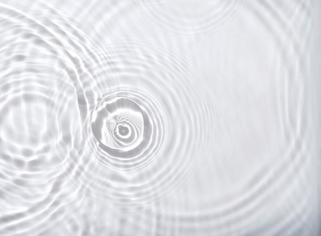 Transparent water surface with ripples waves and splashes background
