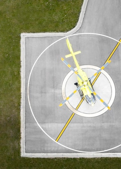 Transport concept with helicopter at helipad