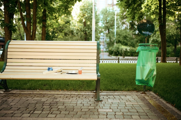 Trash on the bench in park, volunteering motivator. ecological restoration, eco lifestyle, ecology care, environment cleaning concept