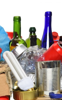 Trash for recycling with,paper, glass bottles, cans, plastic bottle and bulb
