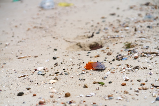 Trash on the sandy beach left by vacationers