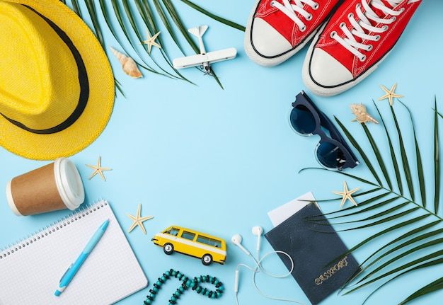 Travel accessories on blue, top view. travel blogger