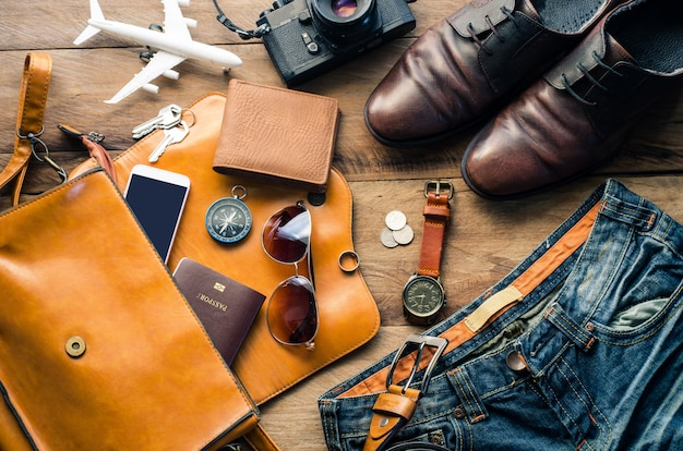 Travel accessories costumes. passports, luggage, the cost of travel maps prepared for the trip