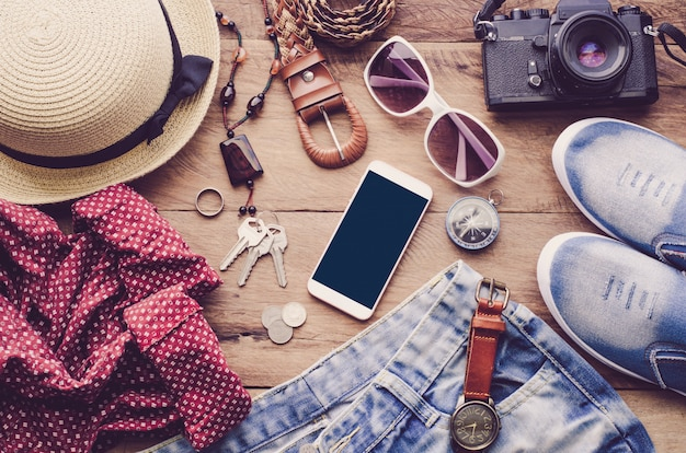 Travel accessories costumes. smart phone, luggage, the cost of travel prepared for the trip