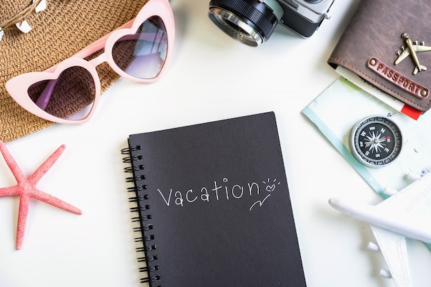 Travel accessories and items with vacation note and copy space, travel concept