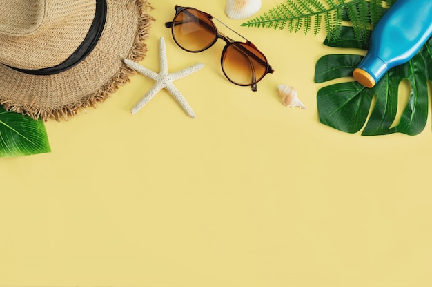 Travel accessories items on yellow background, summer vacation concept