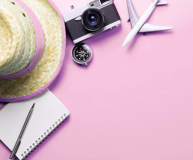 Travel accessories objects and gadgets top view flatlay on pink pastel