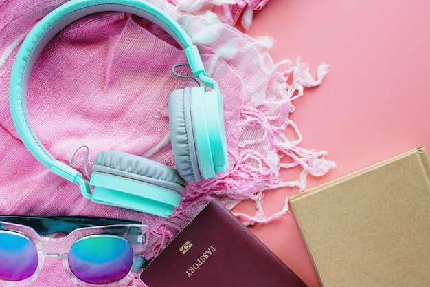 Travel accessories on pink background