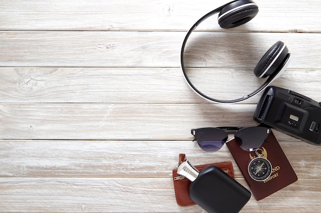 Travel accessories for summer trip on black white wood