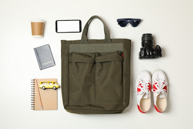 Travel accessories on white, top view
