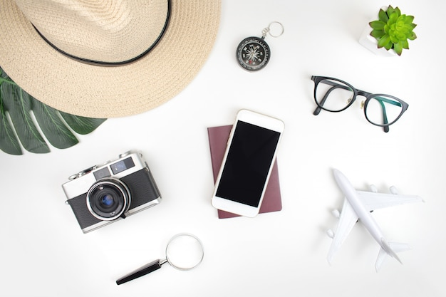Travel accessories with passports prepared for travel on white