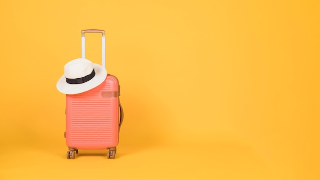 Travel accessories on yellow background