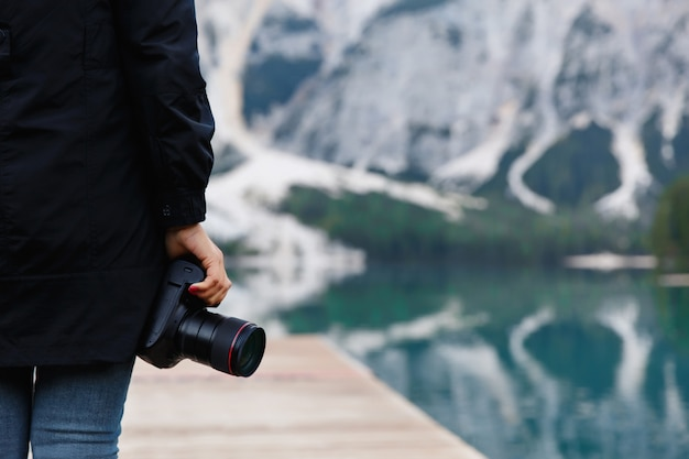 Travel and adventure. hiker, photographer with camera on beautiful landscape