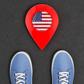 Travel to america concept. blue denim sneakers on the asphalt road with map pointer and usa flag top view extreme closeup. 3d rendering