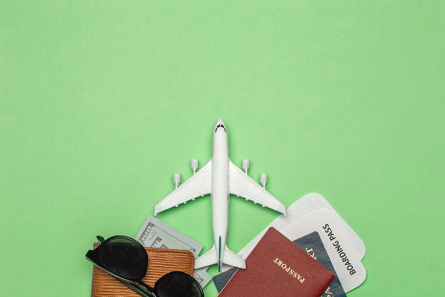 Travel background. items for traveling and flights: tickets, passport, money, sunglasses on a colored background. rest and vacation concept