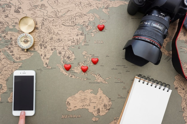 Travel background with mobile phone and decorative objects